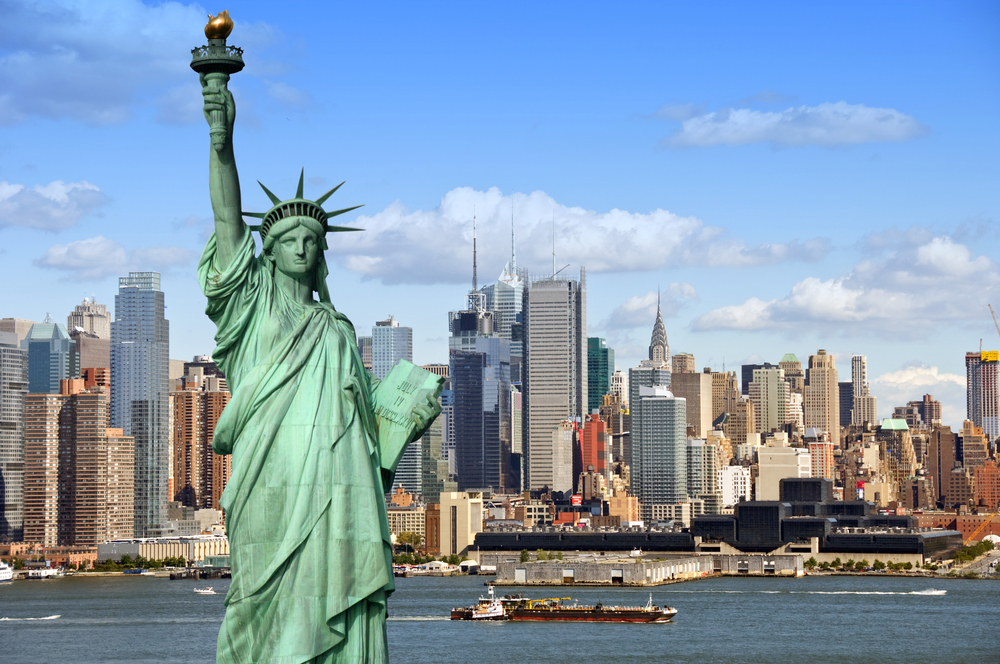 The Statue of Liberty in front of the New York City skyline
